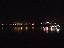 เรือท่องเที่ยว และทิวทัศน์ฝั่งลาว  ยามค่ำคืน